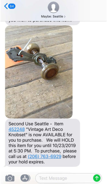 Example of a text message received for a now active hold at Second Use Building Materials.