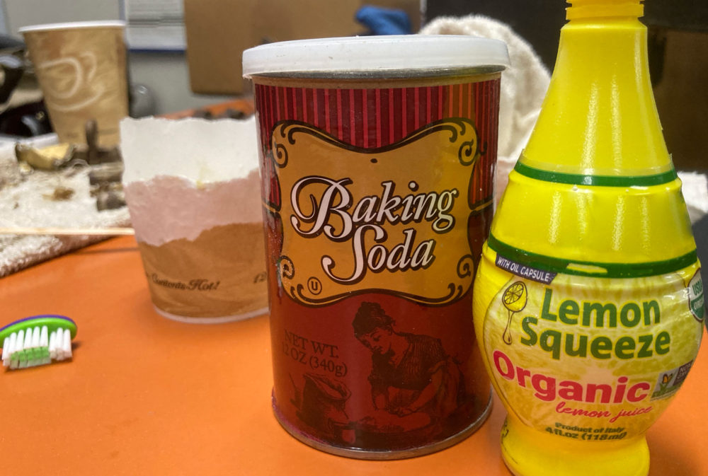 Mix equal parts baking soda and limon juice to make a paste to apply to vintage brass hardware after you have peeled most of the paint away.